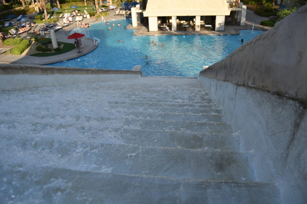 water fall in pool area of cancun vegas resort