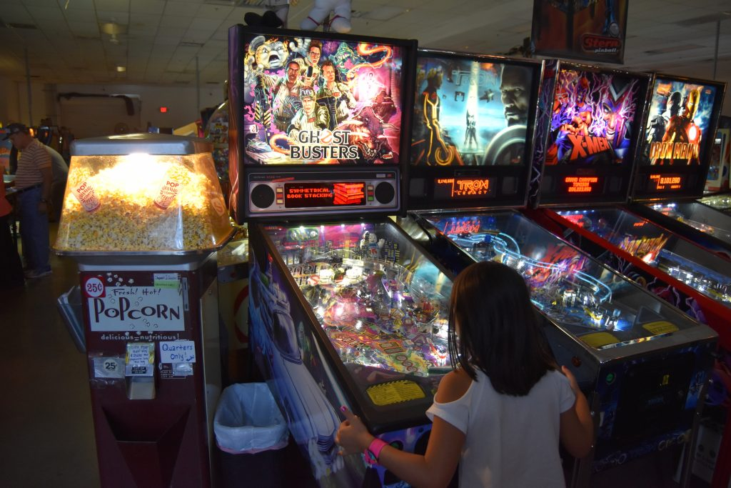Pinball Hall of Fame-Kid playing Ghostbusters pinball machine
