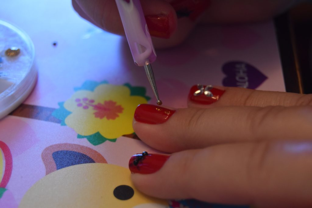 Ant-Man and The Wasp Easy DIY Manicure-Dotting tool being used to paint gold dots on nail