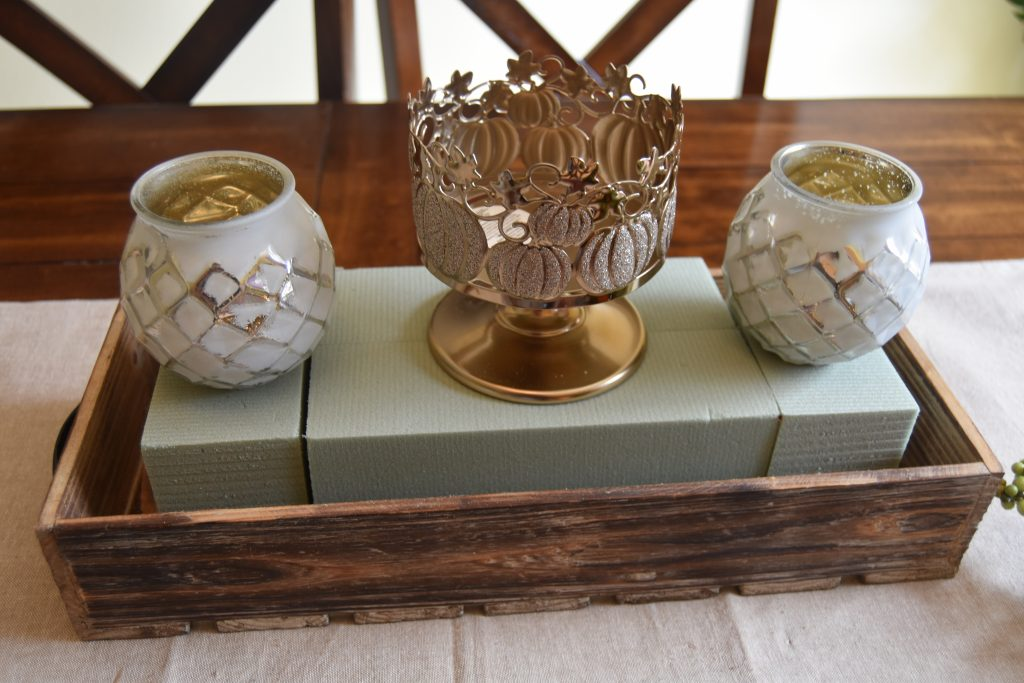 Easy DIY Fall Centerpiece-Three candles placed on top of floral foam inside of wooden box