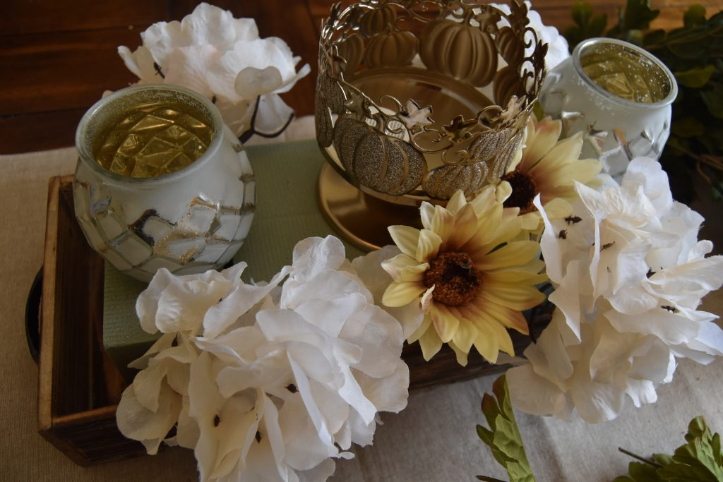 Easy DIY Fall Centerpiece-Cream color flowers placed around the center candle holder.