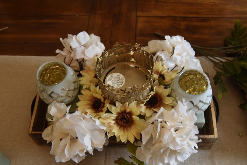 Easy DIY Fall Centerpiece-Cream color flowers placed in a circle around center candle holder