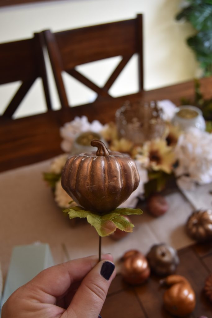 Easy DIY Fall Centerpiece-Decorative gourd pierced with left over leaf twig.