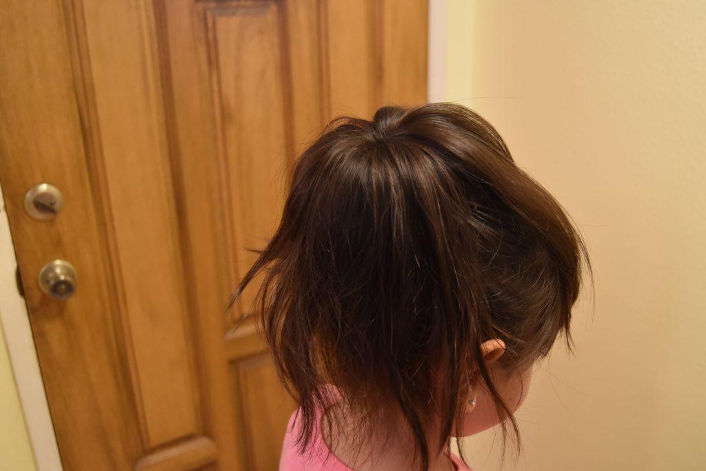 Fall-Inspired Crazy Hair Day Style-Spread hair around foam bun donut