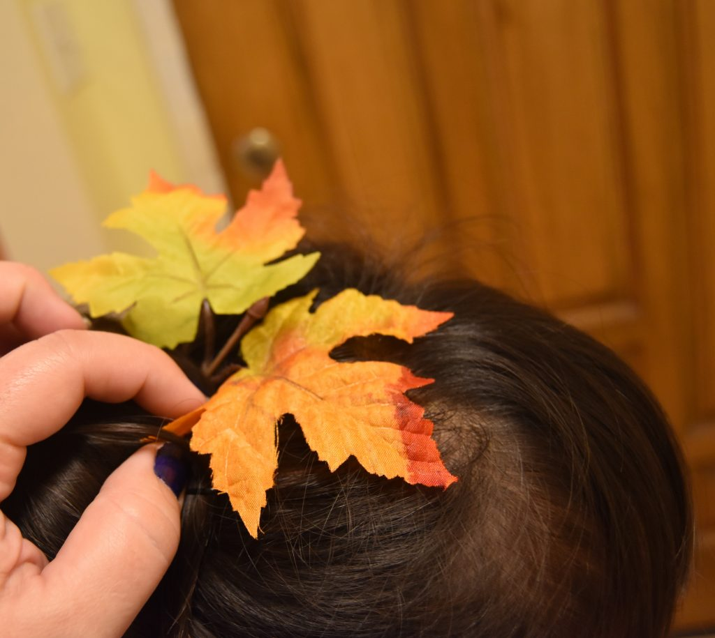 Fall-Inspired Crazy Hair Day Style-Placing leaves in hair