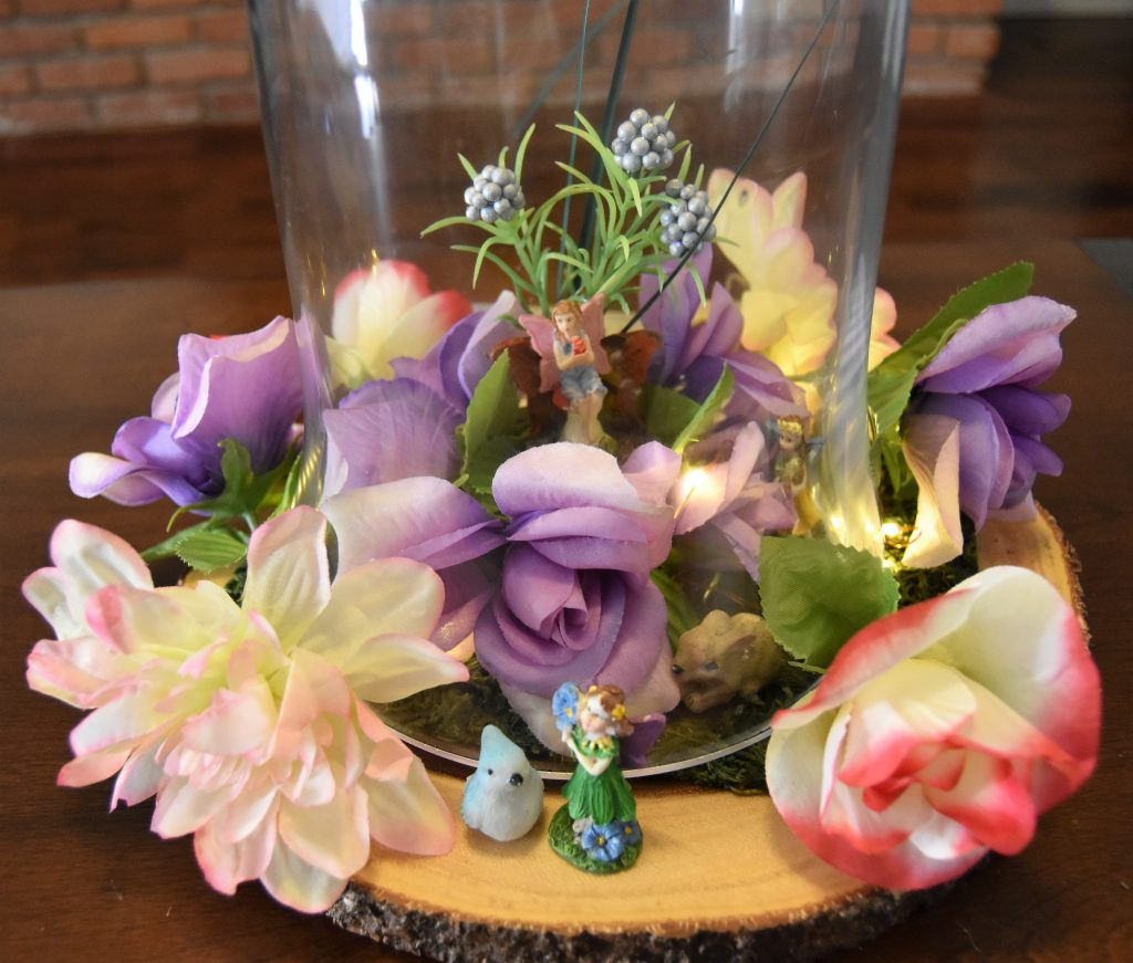 Flowers and Fairy Miniatures placed along the outside-Fairy Cloche Centerpiece DIY