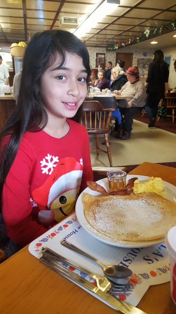 Girl with Danish Pancake-Solvang Danish Village: Is It Worth It?