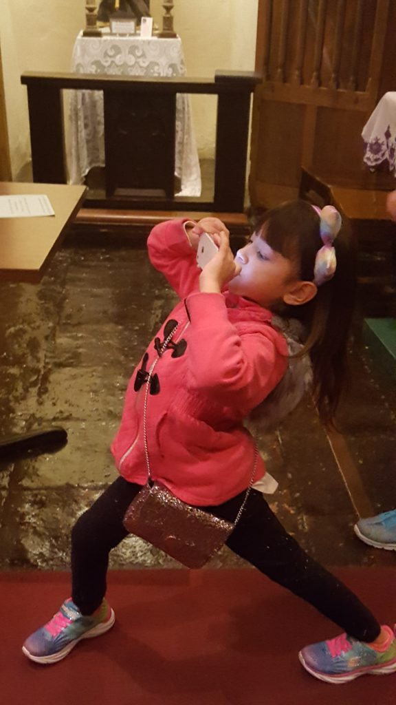 Girl taking picture inside of mission: Instagram Worthy Photo Opps in Solvang
