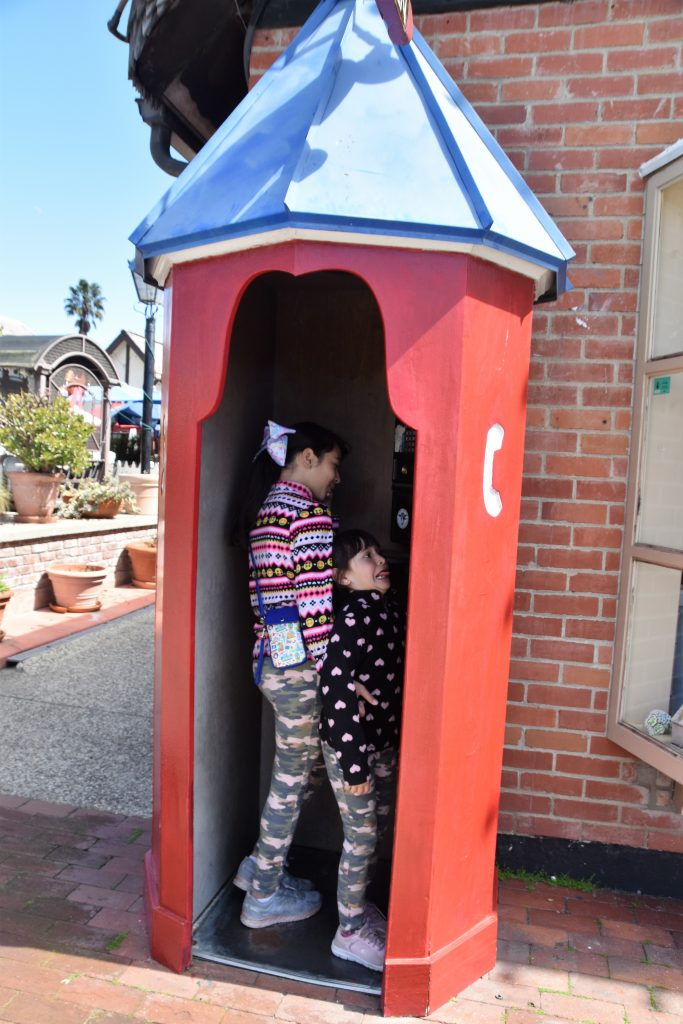 Girls inside old style phone booth-Instagram Worthy Photo Opps In Solvang