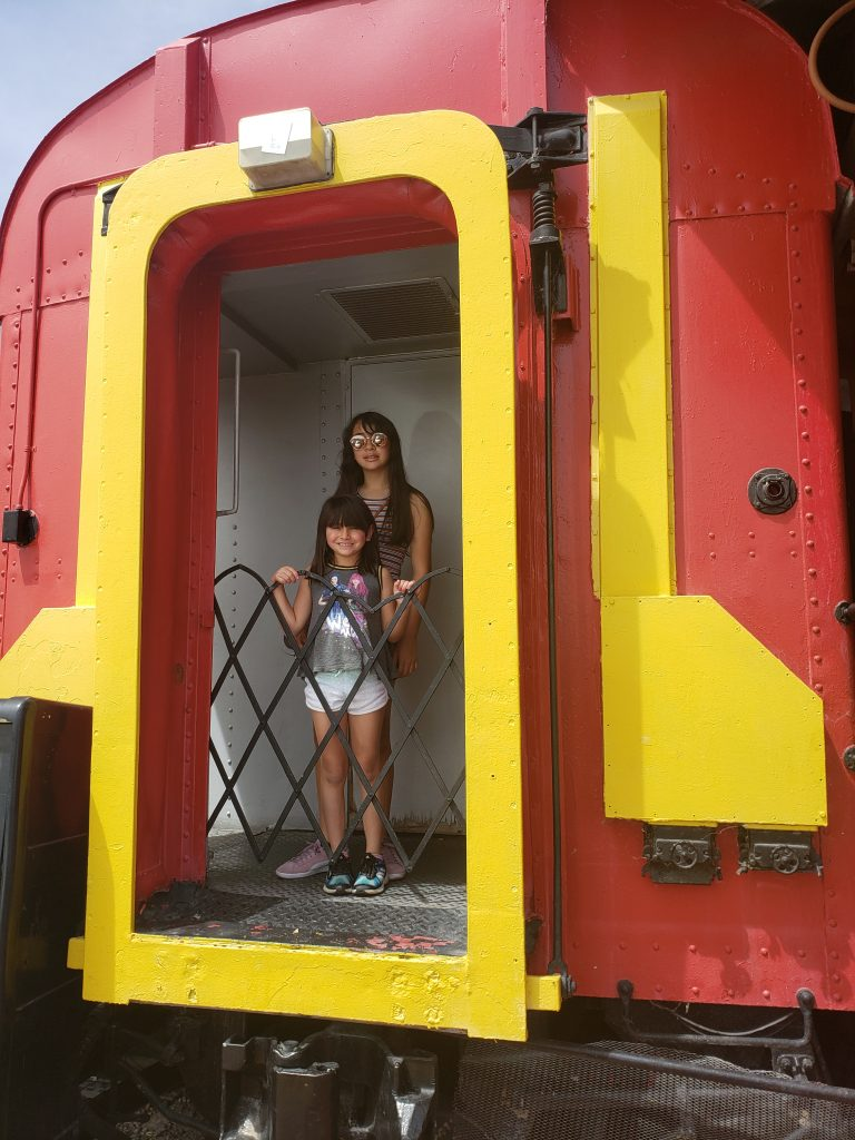 Girls in train car Las Vegas road trip stop