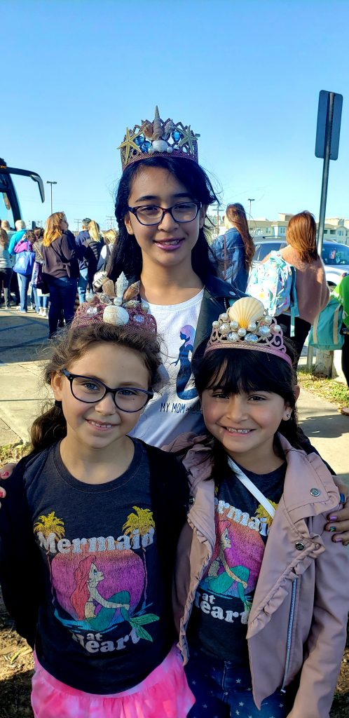 Girls wearing mermaid shell crowns