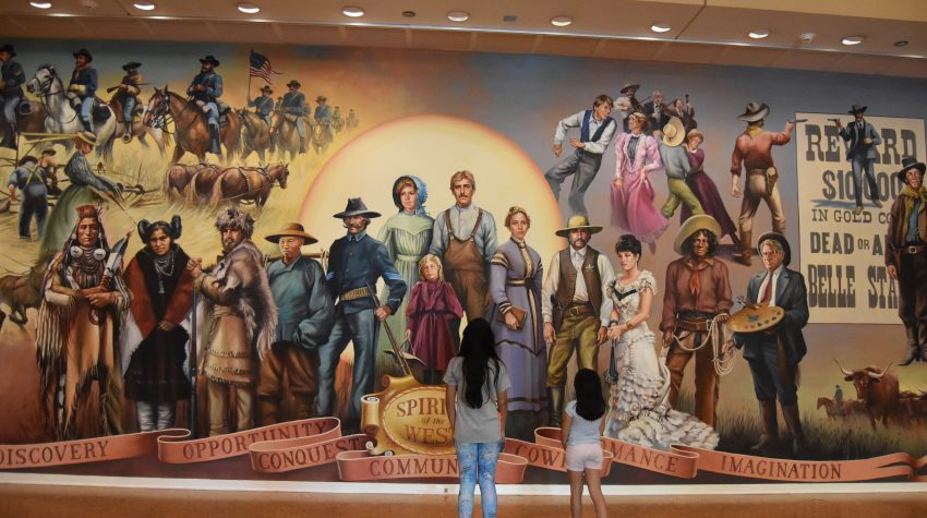 Girls admiring mural of the American West at Autry Museum of the America West