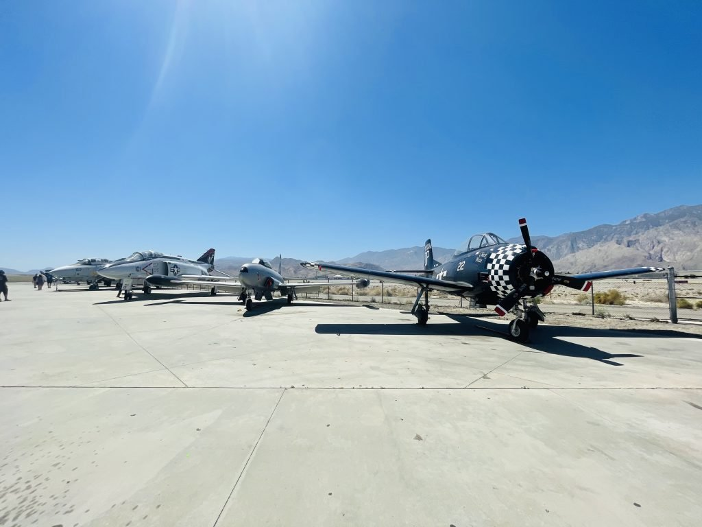 Planes lined up in outdoor section of the museum.